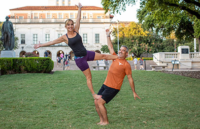 AcroYoga students posing in front of the UT tower