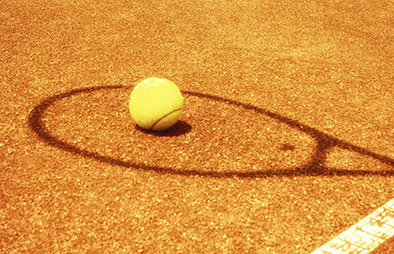 Shadow of a tennis racket with a tennis ball