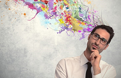 Man thinking with colorful paint splatters