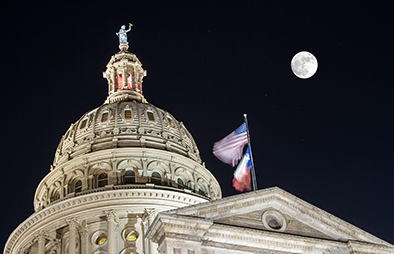 Austin capital building with a full moon.