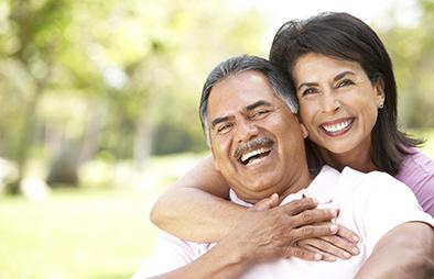 Retired couple laughing together